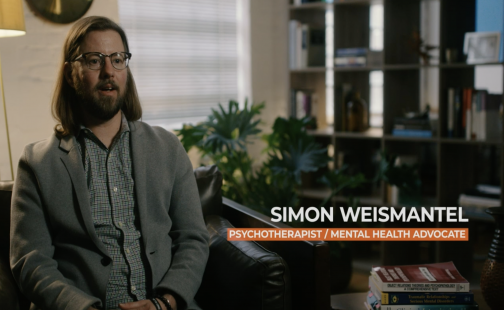 Still shot of Simon Weismantel from interview on NBCLX