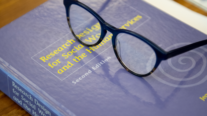 Ph.D. textbook and glasses