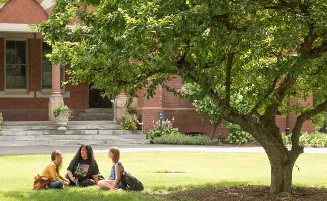 Students relax on the grass at Smith College