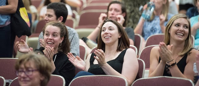 Smith SSW students clapping at a public lecture.
