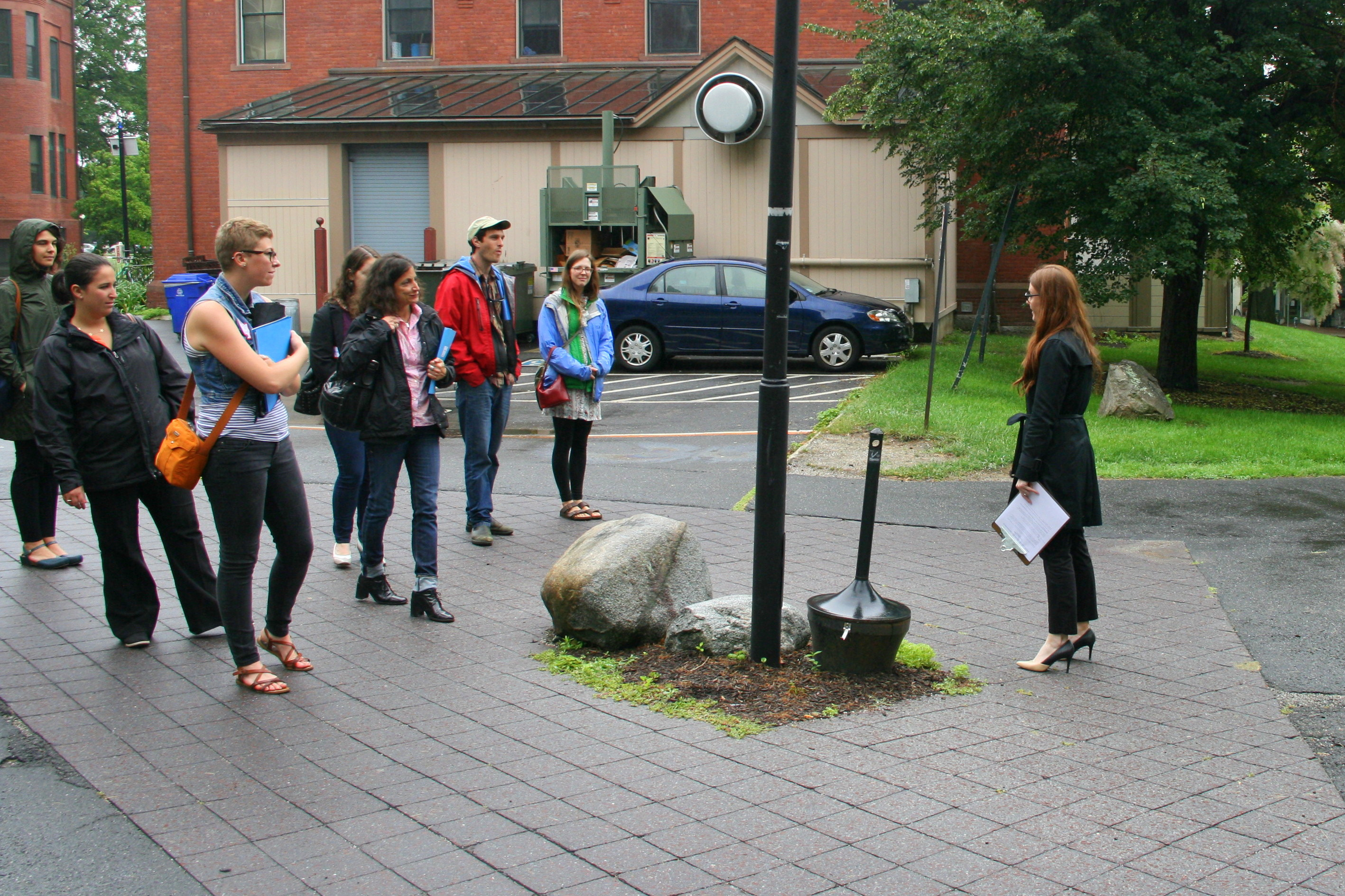 Enrollment Coordinator Karissa Raynor with prospective students outside Seelye Hall