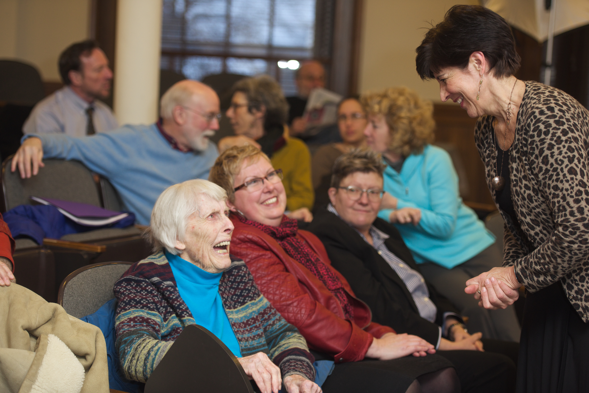 Former Dean Ann Hartman seated beside Dawn Faucher and greeted by Associate Dean Irene Rodriguez-Martin, at Dean Yoshioka's lecture on January 26, 2015