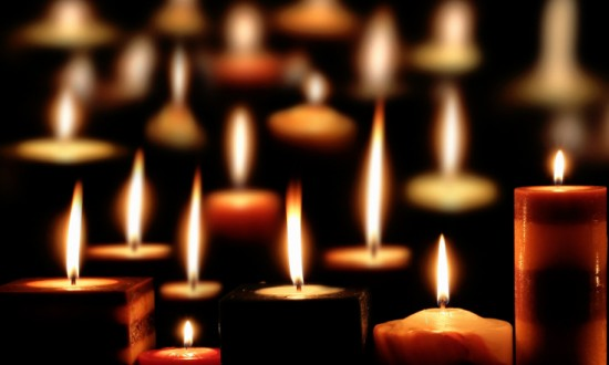 Image of lit candles on dark background