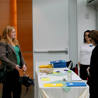 A prospective student talks with Admissions representatives