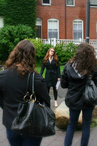 Admissions Coordinator Karissa Raynor leads prospective students on a campus tour during Open House