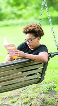 Smith SSW student reading on a swing