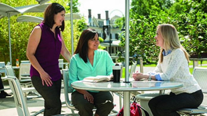Doctoral students outside of the Campus Center Cafe